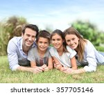 portrait of happy family laying ... | Shutterstock . vector #357705146