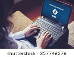 woman updating laptop computer... | Shutterstock . vector #357746276