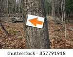 Red Arrow Direction Sign In A...
