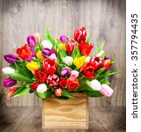tulips in the box on wooden... | Shutterstock . vector #357794435