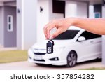 hand with a car key. | Shutterstock . vector #357854282