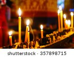 the flame of candles in front... | Shutterstock . vector #357898715