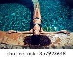 girl relaxing in a pool | Shutterstock . vector #357923648