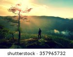 hiker stand at heather bush on... | Shutterstock . vector #357965732