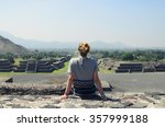 young female sitting on top of... | Shutterstock . vector #357999188