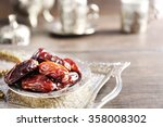 dates fruit and rosary on... | Shutterstock . vector #358008302