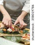 hand arrange sushi for serving | Shutterstock . vector #358019786