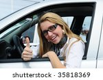 happy woman driving a new car - stock photo
