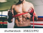 fighter put bandages on his... | Shutterstock . vector #358221992