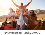 friends on road trip in... | Shutterstock . vector #358229972