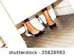 girl in bathroom stall - stock photo