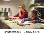 shot of a boy drawing while his ... | Shutterstock . vector #358325276