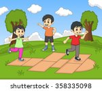 Children Playing Hopscotch At...