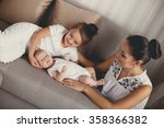 mother with infant boy and... | Shutterstock . vector #358366382