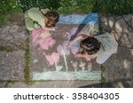 kids drawing with chalk on...   Shutterstock . vector #358404305
