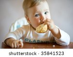 small child sits at a table and ... | Shutterstock . vector #35841523