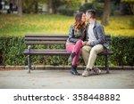 Beautiful Couple Kissing While...