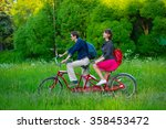 Young Couple Riding On The...