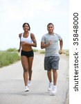Young African American Couple Jogging Outdoor at Park under Summer Sky - stock photo