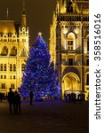 Small photo of BUDAPEST, HUNGARY - DEC 19 2015: Tourists enjoy the Christmas lights at the Parliament House in Budapest, Hungary. This traditional Christmas fair attracts abut 700,000 visitors each year.