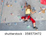 little girl climbing a rock... | Shutterstock . vector #358573472