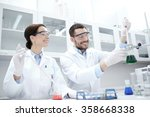 young scientists making test or ... | Shutterstock . vector #358668338