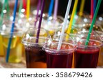 colored drinks in cups | Shutterstock . vector #358679426