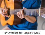 girl playing acoustic guitar... | Shutterstock . vector #358694288