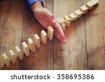 A Male Hand Stoping The Domino...
