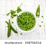 Bowl With Fresh Peas On A...