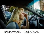 tired girl driving a car. rush... | Shutterstock . vector #358727642