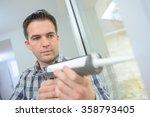 caulking a new window frame | Shutterstock . vector #358793405