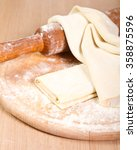 sheets of baking dough on a... | Shutterstock . vector #358875596