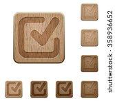 set of carved wooden checkmark...