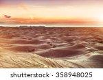 sundown over desert landscape....   Shutterstock . vector #358948025