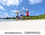 Tourist women three generation family jumping for happy on beach near the sea under sky and clouds of summer at Koh Similan Island in Mu Ko Similan National Park, Phang Nga province, Thailand