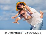 father and daughter playing on... | Shutterstock . vector #359043236