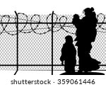 Silhouettes Of Refugee With Tw...