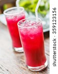 Small photo of Glass of Roselle juice with ice. Traditional beverage. Herbal drink.