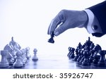 businessman playing chess game blue tone selective focus - stock photo