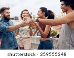 friends enjoying cocktails at a ... | Shutterstock . vector #359555348