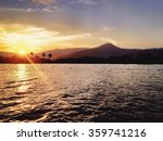 Small photo of The effulgent Sun sets over the DxA5mrei Mountains (Elephant Mountains) and the Kampot River. Kampot, Cambodia.