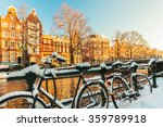 Bicycles Covered With Snow In...