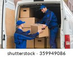young delivery men unloading... | Shutterstock . vector #359949086