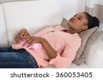 young african woman relaxing on ... | Shutterstock . vector #360053405