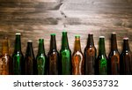 Beer Bottles On A Wooden Table...