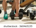 bodybuilder picks up dumbbells. ... | Shutterstock . vector #360465155