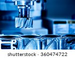 Small photo of Metalworking CNC milling machine. Cutting metal modern processing technology.