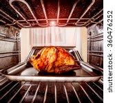 roast chicken in the oven.... | Shutterstock . vector #360476252