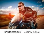 biker in helmet and leather... | Shutterstock . vector #360477212